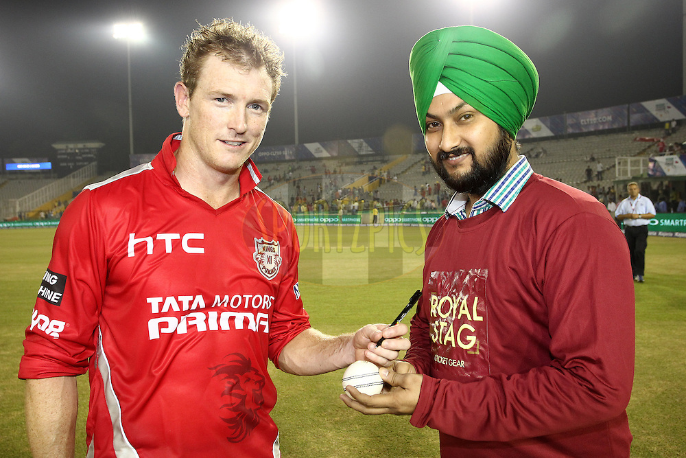 Kings XI Punjab captain George Bailey signs the Match Ball for the Royal Stag Cricket Gear Fan of the match during match 2 of the Oppo Champions League Twenty20 between the Kings XI Punjab and the Hobart Hurricanes held at the Punjab Cricket Association Stadium, Mohali, India on the 18th September 2014<br /> <br /> Photo by:  Shaun Roy / Sportzpics/ CLT20<br /> <br /> <br /> Image use is subject to the terms and conditions as laid out by the BCCI/ CLT20.  The terms and conditions can be downloaded here:<br /> <br /> http://sportzpics.photoshelter.com/gallery/CLT20-Image-Terms-and-Conditions-2014/G0000IfNJn535VPU/C0000QhhKadWcjYs