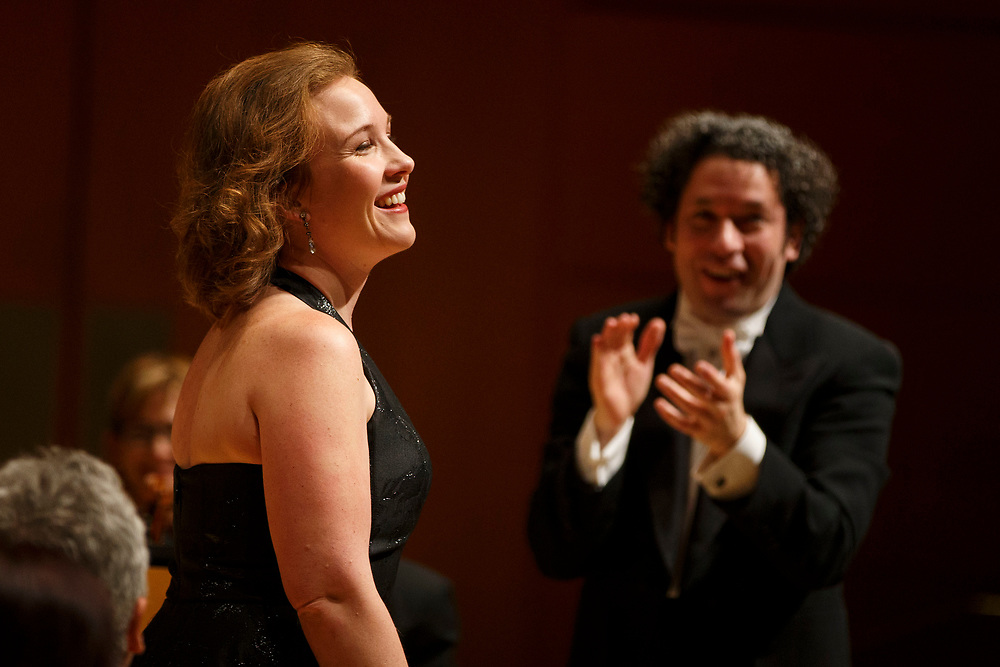 Mezzo-soprano Sasha Cooke smiles as conductor Gustavo Dudamel applauds during the LA Philharmonic at the Walt Disney Concert Hall on Thursday, May 18, 2017 in Los Angeles, Calif. The evening's performance featured Gustavo Dudamel's Schubert symphony as well as a tribute to outgoing president Deborah Borda, followed by a solo vocal from mezzo-soprano Sasha Cooke. © 2017 Patrick T. Fallon