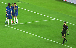 Chelsea's Olivier Giroud celebrates his sides first goal of the game with team mates as Arsenal goalkeeper Petr Cech (right) looks on during the UEFA Europa League final at The Olympic Stadium, Baku, Azerbaijan.