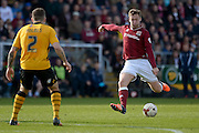 Northampton Town Midfielder Joel Byrom gets a shot away during the Sky Bet League 2 match between Northampton Town and Newport County at Sixfields Stadium, Northampton, England on 25 March 2016. Photo by Dennis Goodwin.