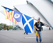 Scottish National Party (SNP) Conference, SEC, Glasgow, Scotland, Great Britain <br /> 8th October 2017 <br /> <br /> <br /> an activist with flags outside conference centre <br /> <br /> <br /> Photograph by Elliott Franks <br /> Image licensed to Elliott Franks Photography Services