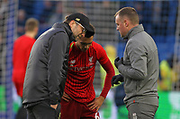 Football - 2018 / 2019 Premier League - Brighton and Hove Albion vs. Liverpool<br /> <br /> Liverpool Manager Jurgen Klopp checks on Trent Alexander-Arnold of Liverpool as he gets checked over by the medical team at The Amex Stadium Brighton <br /> <br /> COLORSPORT/SHAUN BOGGUST