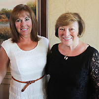 Cathy Cunningham, left, and Carol McLaughlin pose for a photo during Juice, Jazz & Java Saturday September 6, 2014 at Cape Fear National Golf Course in Leland, N.C. (Jason A. Frizzelle)