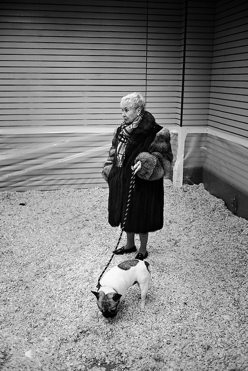Woman in fur coat with dog, New York, NY, US