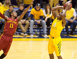 West Virginia Mountaineers guard Juwan Staten (3) shoots a three pointer over Iowa State Cyclones guard Monte Morris