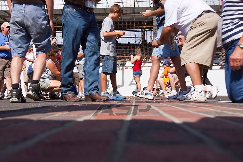 INDIANPOLIS, IN - JUL 29, 2012:  Fans walk the bricks before the Curtiss Shaver 400 presented by Crown Royal at the Indianapolis Motor Speedway in Indianapolis, IN.