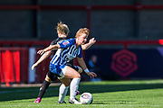 Fliss Gibbons (Brighton) with Erin Cuthbert (Chelsea) during the FA Women's Super League match between Brighton and Hove Albion Women and Chelsea at The People's Pension Stadium, Crawley, England on 15 September 2019.