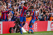 GOAL 4-2. Crystal Palace defender Patrick van Aanholt (3) celebrates with teammate, Crystal Palace forward Wilfried Zaha (11) after scoring a goal during the Premier League match between Crystal Palace and Bournemouth at Selhurst Park, London, England on 12 May 2019.