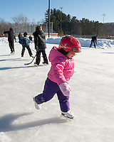 Becca Von George glides across the ice during Laconia Parks and Recreations skating party Friday afternoon at the Memorial Park rink.  (Karen Bobotas/for the Laconia Daily Sun)