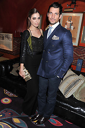 Left to right, AMBER LE BON and DAVID GANDY at the Johnnie Walker Blue Label and David Gandy partnership launch party held at Annabel's, 44 Berkeley Square, London on 5th February 2013.