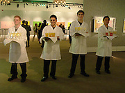 Waiters, Party to celebrate Damien'Hirst's Pharmacy. Sotheby's. 15 October 2004. ONE TIME USE ONLY - DO NOT ARCHIVE  © Copyright Photograph by Dafydd Jones 66 Stockwell Park Rd. London SW9 0DA Tel 020 7733 0108 www.dafjones.com
