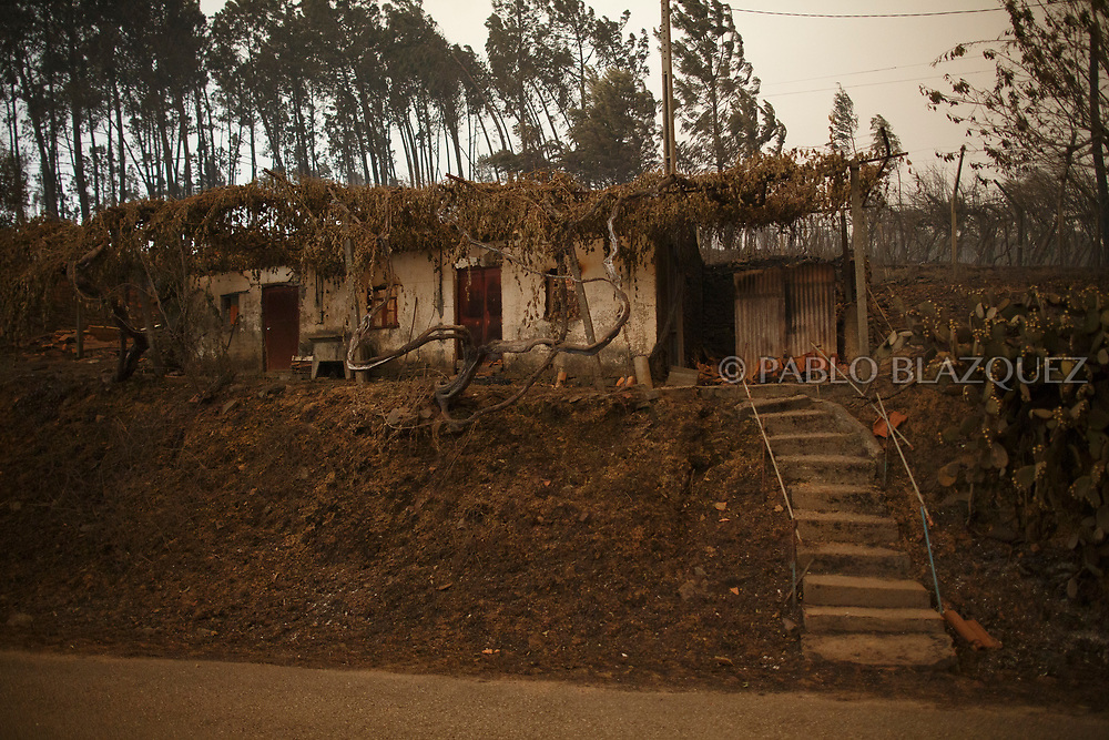 LEIRIA, PORTUGAL - JUNE 18:  A house is burned after a wildfire took dozens of lives on June 18, 2017 near Castanheira de Pera, in Leiria district, Portugal. On Saturday night, a forest fire became uncontrollable in the Leiria district, killing at least 62 people and leaving many injured. Some of the victims died inside their cars as they tried to flee the area.  (Photo by Pablo Blazquez Dominguez/Getty Images)
