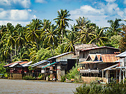18 JUNE 2016 - DON KHONE, CHAMPASAK, LAOS:  Guest houses and hotels for tourists overlooking the Mekong River on Don Khone. Don Khone Island, one of the larger islands in the 4,000 Islands chain on the Mekong River in southern Laos. The island has become a backpacker hot spot, there are lots of guest houses and small restaurants on the north end of the island.    PHOTO BY JACK KURTZ