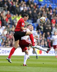 Cardiff City's Mark Hudson battles for the high ball with Bristol City's Steven Davies - Photo mandatory by-line: Joe Meredith/JMP - Tel: Mobile: 07966 386802 16/02/2013 - SPORT - FOOTBALL - Cardiff City Stadium - Cardiff -  Cardiff City V Bristol City - Npower Championship