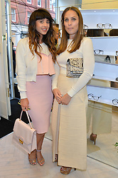 Left to right, singer FOXES and ANNA LAUB founder of Prism at the Prism Boutique Summer Party held at Prism, 54 Chiltern Street, London on 14th May 2014.