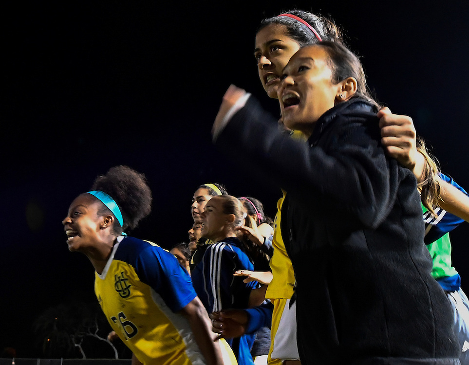 UC Irvine soccer players cheer during penalty kicks in their Big West Tournament semi final overtime victory over Cal State Fullerton Thursday evening.