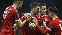 Eric Lichaj celebrates with team mates after giving Forest the lead  during The Emirates FA Cup Third Round match between Nottingham Forest and Arsenal at City Ground on January 7, 2018 in Nottingham, England.