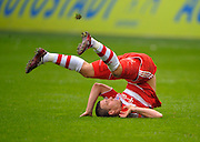 Lukas Podolski takes a tumble during the match between VfL Wolfsburg v Bayern Munich, 4th April 2009.