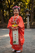 Child dressed in traditional kimono for wedding, Tokyo, Japan