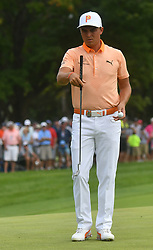 August 12, 2018 - St. Louis, Missouri, U.S. - ST. LOUIS, MO - AUGUST 12: Rickie Fowler lines up a putt on the #1 green during the final round of the PGA Championship on August 12, 2018, at Bellerive Country Club, St. Louis, MO.  (Photo by Keith Gillett/Icon Sportswire) (Credit Image: © Keith Gillett/Icon SMI via ZUMA Press)