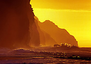 "Waves crash at sunset on Kalalau Beach, Na Pali Coast, Kauai, Hawaii, USA. Published in ""Light Travel: Photography on the Go"" by Tom Dempsey 2009, 2010."
