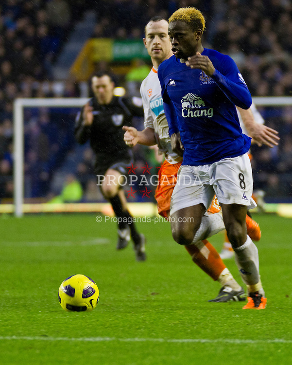 LIVERPOOL, ENGLAND - Saturday, February 5, 2011: Everton's Louis Saha runs past Blackpool's captain Charlie Adam to score his fourth goal of the match to make it 5-3 during the Premiership match at Goodison Park (Photo by Vegard Grott/Propaganda).