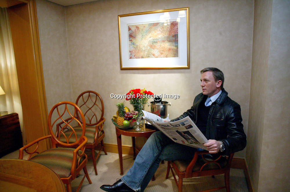 BEIJING, JANUARY-29: Daniel Craig reads a paper in barbara's suite before the premiere of Casino Royale in Beijing.