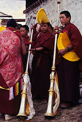 Asia, Nepal, Himalayas, Solu Khumbu region. Buddhist lamas (monks) with long horns at Mani-Rimdu festival, Tengboche Monastery.