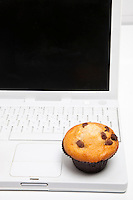 Close-up of cupcake and laptop
