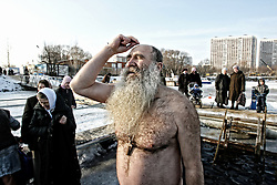 A Russian orthodox believer crosses himself before his icy bath in Moskva-river, while celebrating Epiphany holiday in Moscow, Russia, 18 January 2007. People believe that blessed waters in the holiday of Epiphany strengthen their spirit and body.