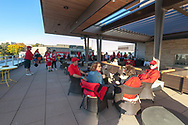 Badger fans lounge on the upper deck patio at the Homecoming Badger Bash celebration at Union South before the Badgers take on Maryland.