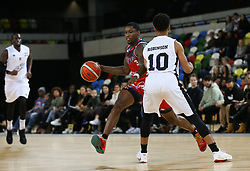 Fred Thomas of Bristol Flyers drives at Justin Robinson of London Lions - Photo mandatory by-line: Arron Gent/JMP - 20/11/2019 - BASKETBALL - Copper Box Arena - London, England - London Lions v Bristol Flyers - British Basketball League Cup
