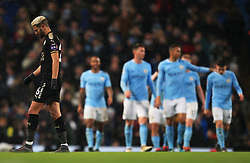 Riyad Mahrez of Leicester City looks dejected as Sergio Aguero of Manchester City celebrates after scoring his fourth goal - Mandatory by-line: Matt McNulty/JMP - 10/02/2018 - FOOTBALL - Etihad Stadium - Manchester, England - Manchester City v Leicester City - Premier League