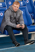 Interim Celtic Manager Neil Lennon sits alone in the away dugout ahead of the Ladbrokes Scottish Premiership match between Rangers and Celtic at Ibrox, Glasgow, Scotland on 12 May 2019.