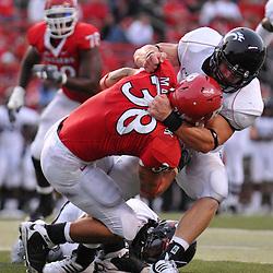 Sep 7, 2009; Piscataway, NJ, USA;  Rutgers running back Joe Martinek (38) is wrapped up by Cincinnati linebacker J.K. Schaffer (37) during the second half as Cincinnati defeats Rutgers 47-15 in NCAA Big East football at Rutgers Stadium.