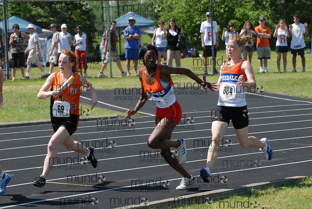 Hamilton, Ontario ---06/06/08--- Cassandra Norton of Innisdale in Barrie competes in the 4X100 meter relay at the 2008 OFSAA Track and Field meet in Hamilton, Ontario..Mark Butterwick