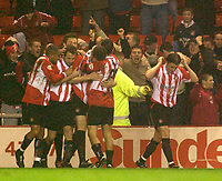 Photo. Glyn Thomas.<br /> Sunderland v Birmingham. FA Cup fifth round.<br /> Stadium of Light, Sunderland. 14/02/2004.<br /> Sunderland's Kevin Kyle (C) is congratulated by teammates after putting his side level.