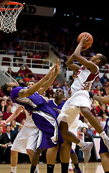 February 13, 2010; Stanford, CA, USA;  Stanford Cardinal guard Jarrett Mann (22) shoots over Washington Huskies forward Tyreese Breshers (33) during the first half at Maples Pavilion.  Washington defeated Stanford 78-61.