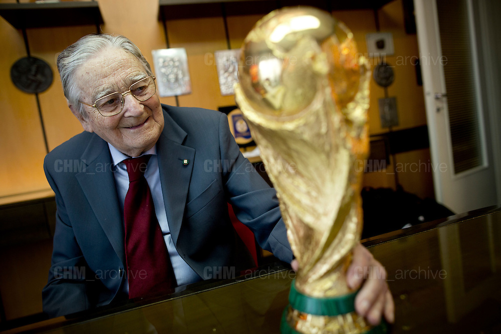 Silvio Gazzaniga, sculptor and creator of the FIFA World cup, stares at a copy of the trophy in the offices of the G.D.E. Bertoni, the company which he worked for since 1953 and where he created the World Cup. Paderno Dugnano, Milan, Italy, 28 january 2014. Guido Montani / OneShot