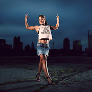 Fitness athlete Melitta (Mel) Simmons poses for Fit Columbus magazine's August issue in downtown Columbus, Ohio on Saturday, July 26 2014.  (Photo by Leonardo Carrizo)