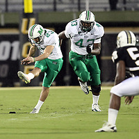 Marshall kicker Justin Haig (23) kicks off during an NCAA football game between the Marshall Thundering Herd and the Central Florida Knights at Bright House Networks Stadium on Saturday, October 8, 2011 in Orlando, Florida. (Photo/Alex Menendez)