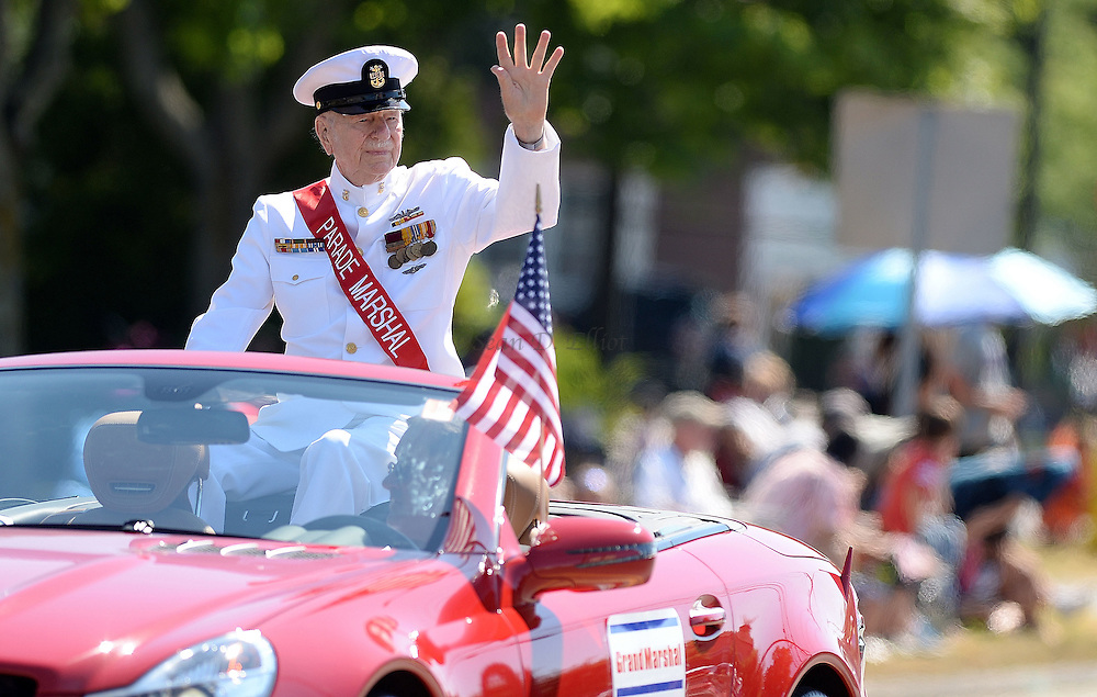 7/4/16 :: REGION :: SMITH :: Parade Grand Marshal J. Deen Brown waves to spectators as the Groton Independence Day Parade passes the crowds on Poquonnock Rd. Monday, July 4, 2016. (Sean D. Elliot/The Day)