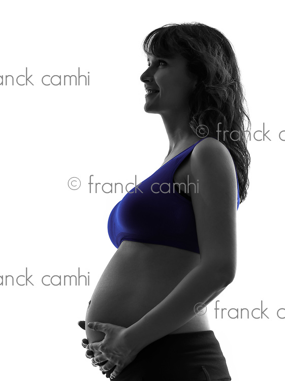 one  pregnant woman portrait profile in silhouette studio on white background