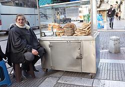 January 3, 2018 - Thessaloniki, Greece - A woman  sells fresh-baked in Thessaloniki, Greece, on January 3, 2018. (Credit Image: © Grigoris Siamidis/NurPhoto via ZUMA Press)