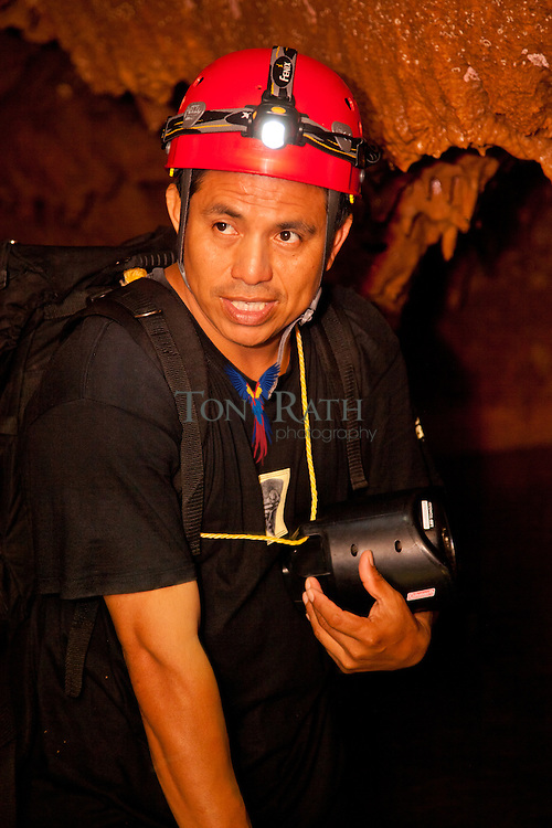 Tour guide, Hector Bol, explains history of ancient Mayan cave, the Actun Tunichil Muknal Natural Monument, in the Tapir Mountain Nature Reserve, Teakettle Village, Cayo District, Belize.
