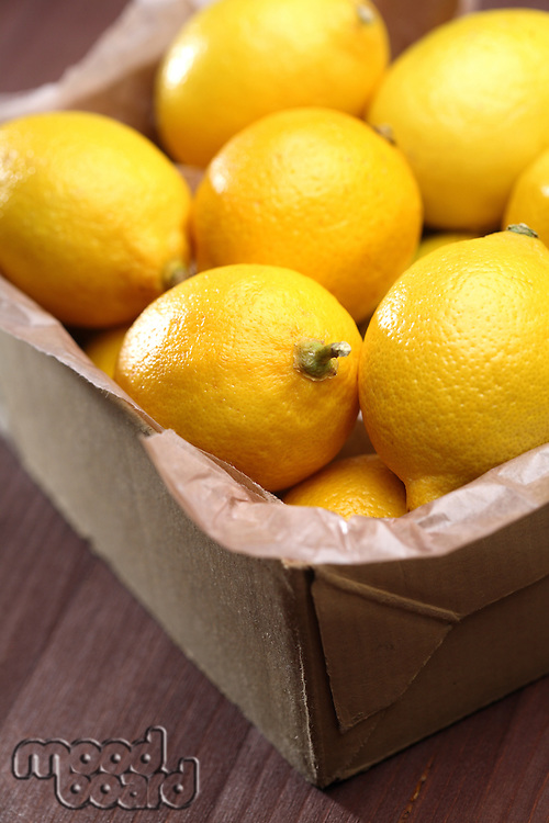 Lemons in box - close-up