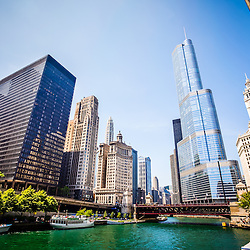 Picture of Chicago skyline at Michigan Avenue Bridge (DuSable Bridge) in downtown Chicago with the Chicago River, One Illinois Center, 333 North Michigan Avenue, London Guarantee Building, Leo Burnett Building, United Airlines Building, Trump Tower, and Wrigley Building.