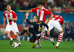 Andres Iniesta of Spain vs Victor Caceres of Paraguay and Antolin Alcaraz of Paraguay during the  2010 FIFA World Cup South Africa Quarter Finals football match between Paraguay and Spain on July 03, 2010 at Ellis Park Stadium in Johannesburg. (Photo by Vid Ponikvar / Sportida)