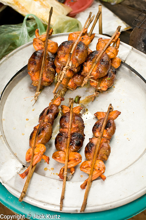 02 JULY 2006 - UDONG, CAMBODIA: Grilled frogs, a Cambodian delicacy, for sale in a park near Udong, Cambodia. Photo by Jack Kurtz / ZUMA Press