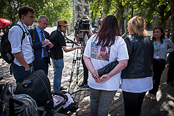 © Licensed to London News Pictures. 06/07/2016. London, UK. KARLA ELLIS (left), sister of Private Lee Ellis, 23, of Wythenshawe who died during a home-made bomb explosion, being comforted as she is interviewed by media  outside the QE2 conference centre in London where the long-awaited Chilcot inquiry into the war in Iraq has been released. Photo credit: Ben Cawthra/LNP
